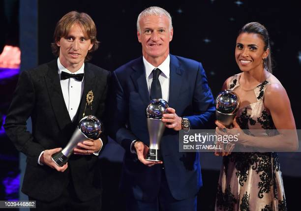 TOPSHOT France's coach Didier Deschamps winner of the Best FIFA Men's Coach of 2018 Award is flanked by Orlando Pride and Brazil forward Marta and...