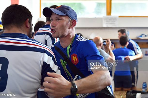 France's coach Gerald Bastide hugs France's n°8 Fabien Sanconnie in the locker room prior to the Rugby Union World Cup U20 championship semifinal...