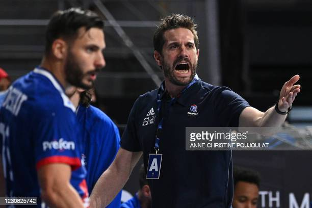 France's coach Guillaume Gille reacts on the sideline during the 2021 World Men's Handball Championship quarterfinal match between France and Hungary...