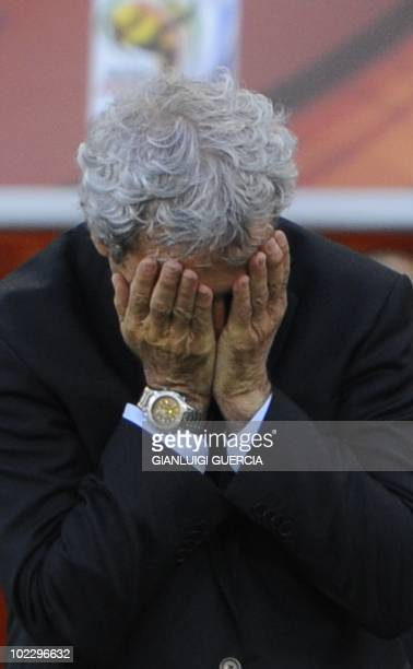 France's coach Raymond Domenech reacts after South Africa scored a second goal during the Group A first round 2010 World Cup football match France vs...