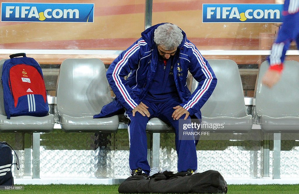 France's coach Raymond Domenech sits on a bench during a training session at the Peter Mokaba stadium in Polokwane, on June 16, 2010. France will play against Mexico in their second first-round match of the 2010 Football World Cup on June 17.
