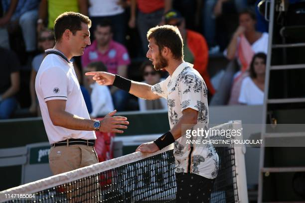 France's Corentin Moutet argues with the referee during his men's singles third round match against Argentina's Juan Ignacio Londero on day six of...
