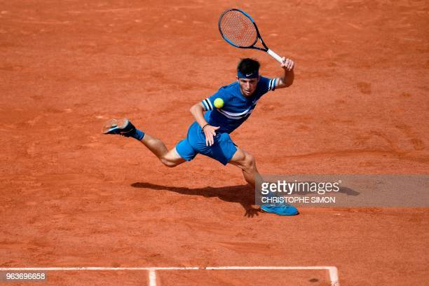 France's Corentin Moutet plays a forehand return to Belgium's David Goffin during their men's singles second round match on day four of The Roland...