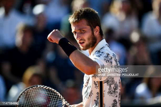 France's Corentin Moutet reacts during his men's singles third round match against Argentina's Juan Ignacio Londero on day six of The Roland Garros...