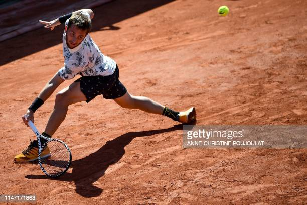 France's Corentin Moutet returns the ball to Argentina's Juan Ignacio Londero during their men's singles third round match on day six of The Roland...