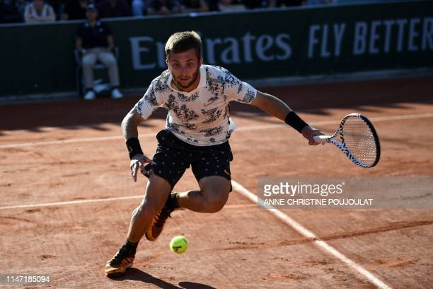 France's Corentin Moutet returns the ball to Argentina's Juan Ignacio Londero during his men's singles third round match on day six of The Roland...