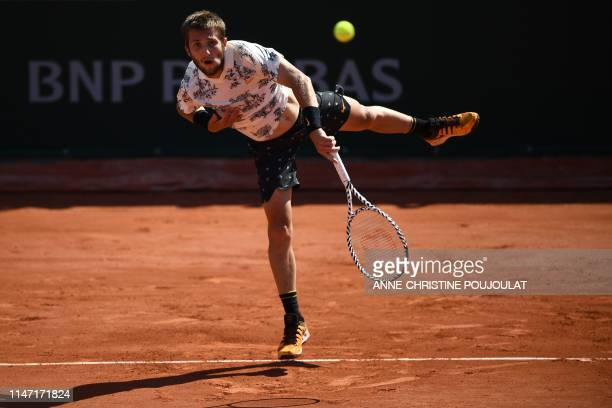 France's Corentin Moutet serves the ball to Argentina's Juan Ignacio Londero during their men's singles third round match on day six of The Roland...