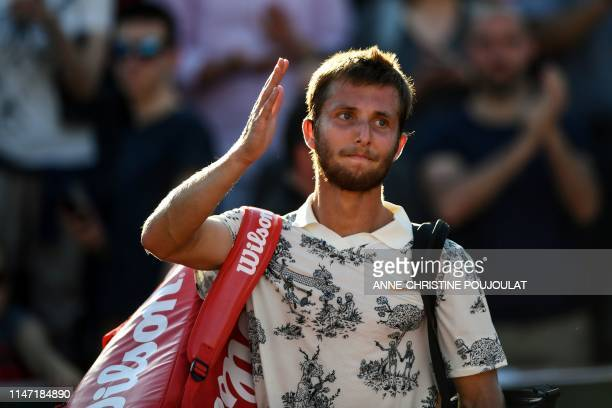 France's Corentin Moutet waves as he leaves the court after his men's singles third round match against Argentina's Juan Ignacio Londero on day six...