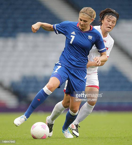 France's Corine Franco vies with North Korea's Jon Myong Hwa during the London 2012 Olympic Games women's football match at Hampden Park Glasgow...
