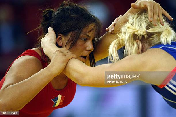 France's Cynthia Vanessa Vescan fights with Estonia's Epp Mae during the qualification round of the women's free style 72 kg category of the World...