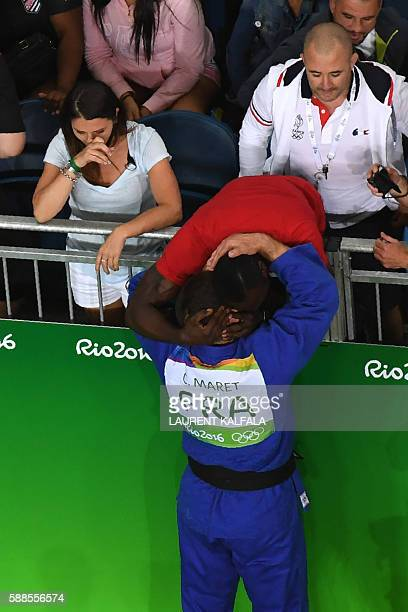 France's Cyrille Maret celebrates after defeating Germany's KarlRichard Frey during their men's 100kg judo contest bronze medal A match of the Rio...