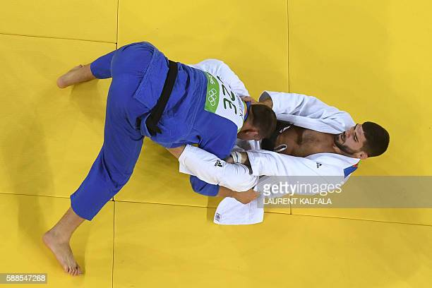 France's Cyrille Maret competes with Czech Republic's Lukas Krpalek during their men's 100kg judo contest semifinal B match of the Rio 2016 Olympic...