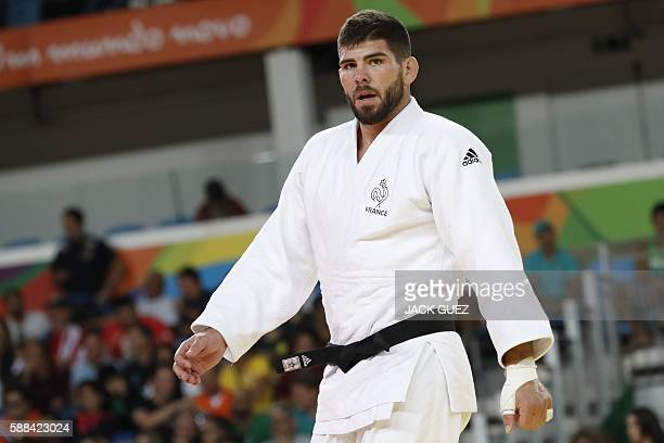 France's Cyrille Maret competes with Georgia's Beka Gviniashvili during their men's 100kg judo contest quarterfinal match of the Rio 2016 Olympic...