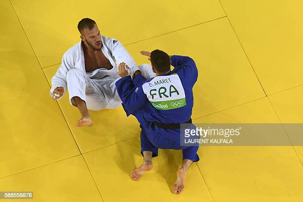 France's Cyrille Maret competes with Germany's KarlRichard Frey during their men's 100kg judo contest bronze medal A match of the Rio 2016 Olympic...