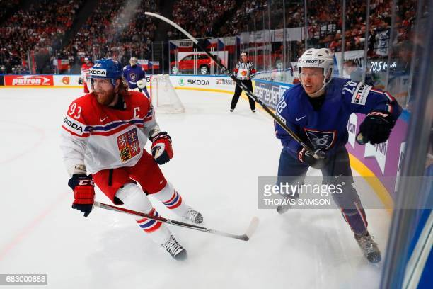 France's Damien Raux vies with Czech Republic's Jakub Voracek during the IIHF Men's World Championship group B ice hockey match between France and...