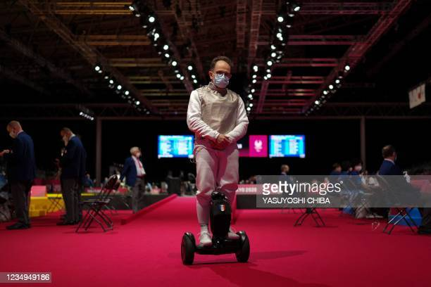France's Damien Tokatlian rides on his transporter during the semi-final wheelchair fencing match of men's foil team between France and Britain at...