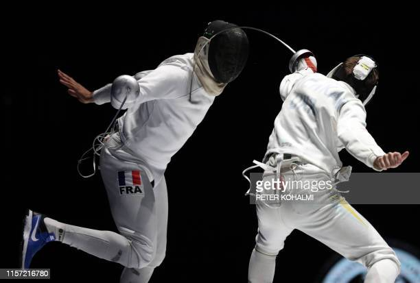 France's Daniel Jerent and Ukraine's Roman Svichkar compete in the Men's Epee team final at the 2019 Fencing World Championships in Budapest Hungary...