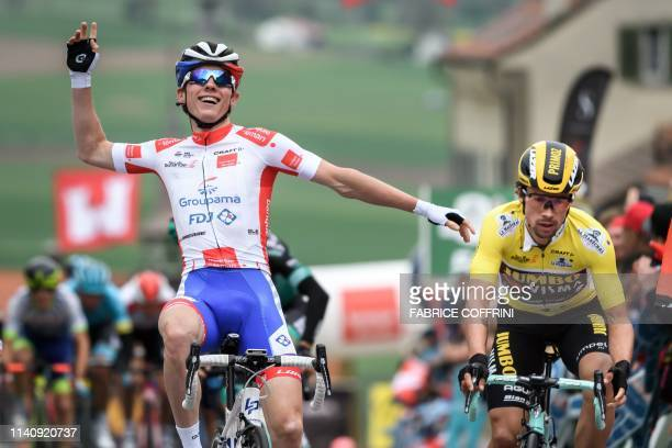 France's David Gaudu celebrates next to Slovenia's Primoz Roglic after winning the 3rd stage 160 km loop from Romont to Romont during the Tour de...