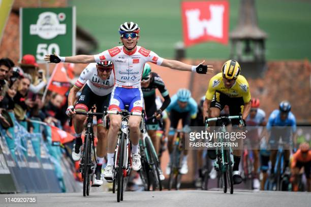 France's David Gaudu raises his arms after winning the 3rd stage, 160 km loop from Romont to Romont during the Tour de Romandie UCI World Tour 2019...