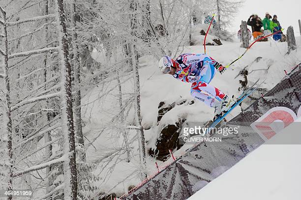 France's David Poisson competes during the FIS men's Alpine World Cup Downhill race in Kitzbuehel on January 25 2014 AFP PHOTO / OLIVIER MORIN