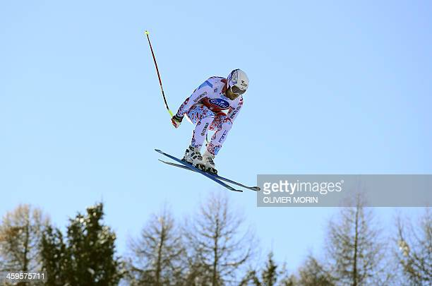 France's David Poisson competes in the Alpine World Cup Men's Downhill training event on December 28 2013 in Bormio northern Italy AFP PHOTO /...