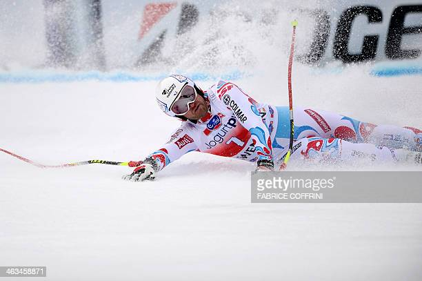 France's David Poisson falls in the finish area after competing in the FIS men's Alpine World Cup downhill in Wengen on January 18 2014 AFP PHOTO /...