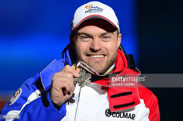 France's David Poisson holds his bronze medal during the medal ceremony after the men's downhill event of the 2013 Ski World Championships in...