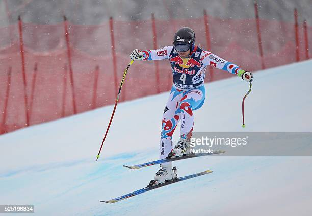 France's David Poisson races down the famous Hahnenkamm course during the men's Downhill at the FIS SKI World Cup in Kitzbuehel 24 January 2015...