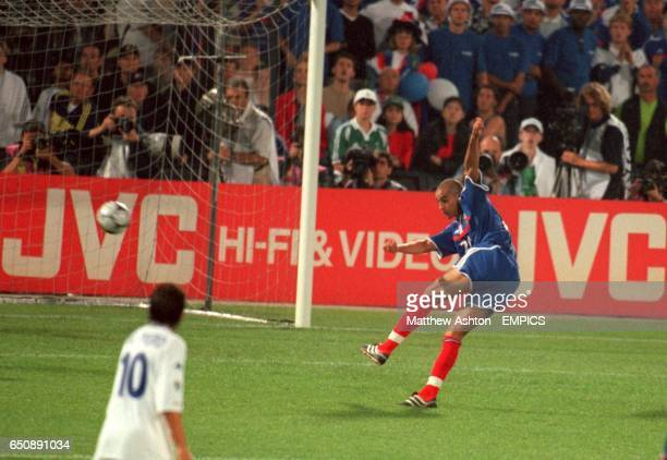 France's David Trezeguet scores the winning goal of the final of Euro 2000 during the 'golden goal' period of the game