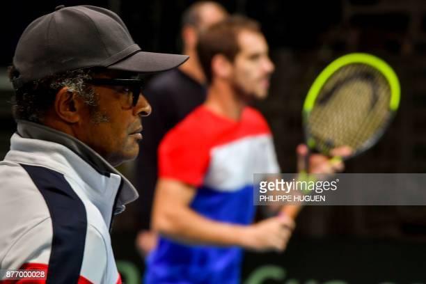 France's Davis Cup team captain Yannick Noah supervises a training session on November 21 2017 at the PierreMauroy stadium in Villeneuve d'Ascq ahead...