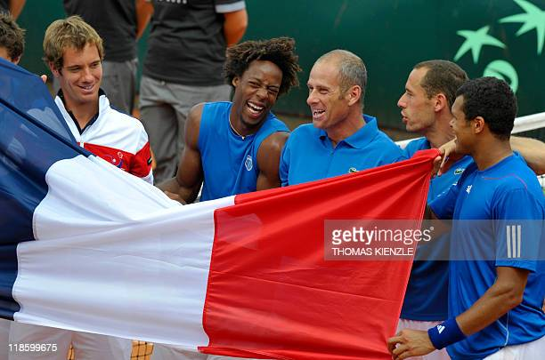 France's Davis Cup Team Richard Gasquet Gael Monfils team captain Guy Forget Michael Llodra and JoWilfried Tsonga celebrate with the French national...