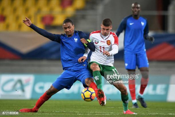 France's defender Abdou Diallo vies with Bulgaria's forward Kiril Despodov during the Euro 2019 U21 qualifying football match between France and...