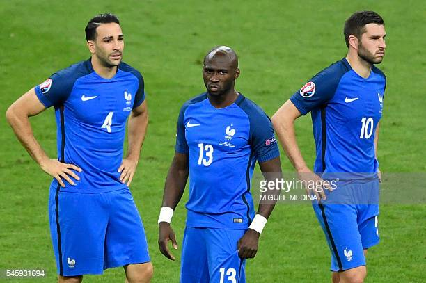 France's defender Adil Rami France's defender Eliaquim Mangala and France's forward AndrePierre Gignac look on after their team's defeat in the Euro...