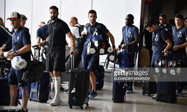 TOPSHOT France's defender Adil Rami goalkeeper Hugo Lloris defender Samuel Umtiti forward Florian Thauvin and defender Benjamin Pavard depart home...