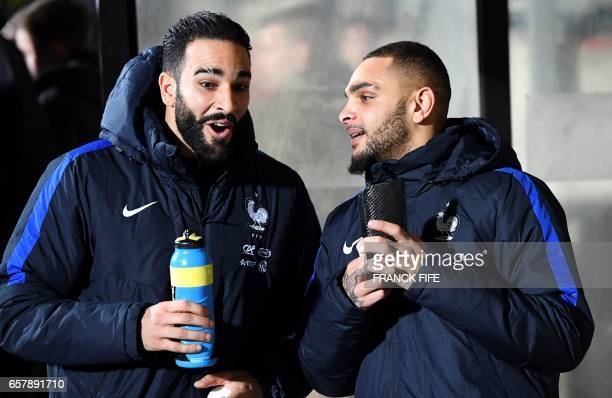 France's defender Adil Rami jokes with France's defender Layvin Kurzawa before the FIFA World Cup 2018 qualifying football match Luxembourg vs France...