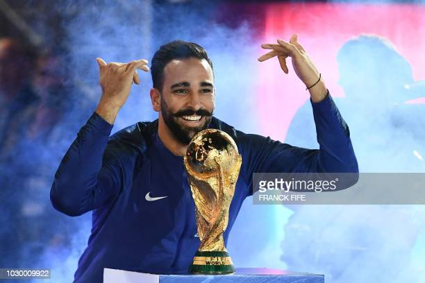 TOPSHOT France's defender Adil Rami poses with the 2018 World Cup trophy before the lap of honour at the end of the UEFA Nations League football...