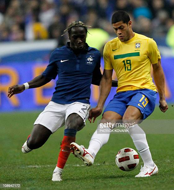 France's defender Bacary Sagna vies with Brazil's forward Givaldinho Hulk during the friendly football match France versus Brazil on February 9 2011...