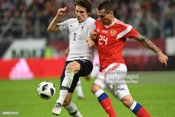 France's defender Benjamin Pavard and Russia's forward Anton Zabolotny vie for the ball during an international friendly football match between...