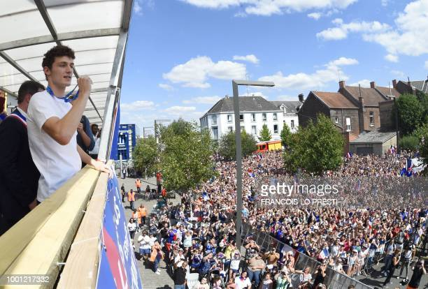 France's defender Benjamin Pavard shows his medal to the crowd gathered in his home town of Jeumont northern France on July 18 2018 three days after...