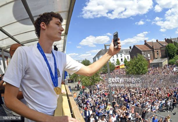 France's defender Benjamin Pavard takes a picture of the crowd gathered in his home town of Jeumont northern France on July 18 2018 three days after...