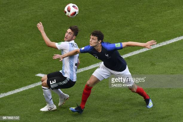 France's defender Benjamin Pavard vies for the ball with Argentina's defender Nicolas Tagliafico during the Russia 2018 World Cup round of 16...