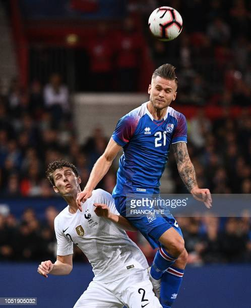 France's defender Benjamin Pavard vies with Iceland's midfielder Arnor Ingvi Traustason during the friendly football match between France and Iceland...