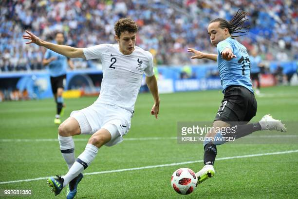 TOPSHOT France's defender Benjamin Pavard vies with Uruguay's defender Diego Laxalt during the Russia 2018 World Cup quarterfinal football match...