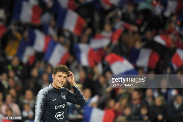 France's defender Benjamin Pavard warms up ahead of the friendly football match between France and Iceland at the Roudourou Stadium in Guingamp...