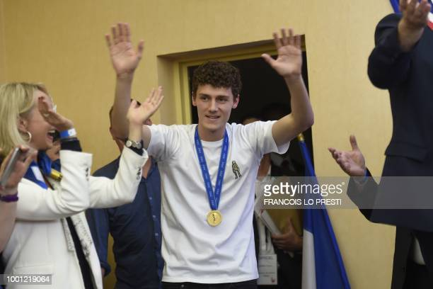 France's defender Benjamin Pavard waves as he arrives at the townhall in his home town of Jeumont northern France on July 18 2018 three days after...