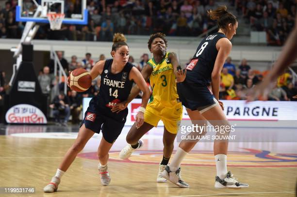 France's defender Bria Hartley fights for the ball with Brazilian's defender Isabela Ramona during the FIBA Women's Olympic Qualifying Tournament...