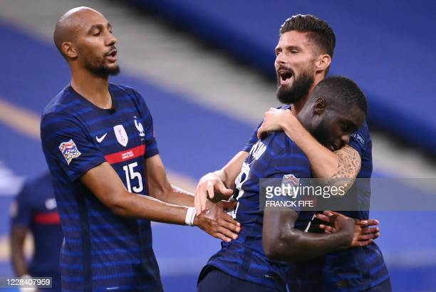 France's defender Dayot Upamecano celebrates with France's forward Olivier Giroud and France's midfielder Steven Nzonzi after scoring a goal during...