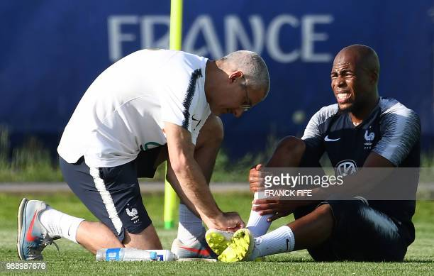 France's defender Djibril Sidibe reacts after sustaining an injury during a training session at the Glebovets stadium in Istra some 70 km west of...