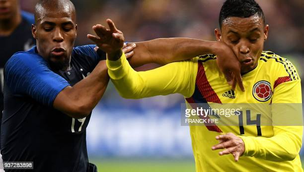 France's defender Djibril Sidibe vies for the ball with Colombia's forward Luis Fernando Muriel during the friendly football match between France and...