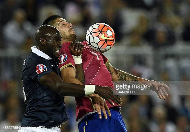 France's defender Eliaquim Mangala vies with Serbias defender Stefan Mitrovic during the Euro 2016 friendly football match France vs Serbia at the...